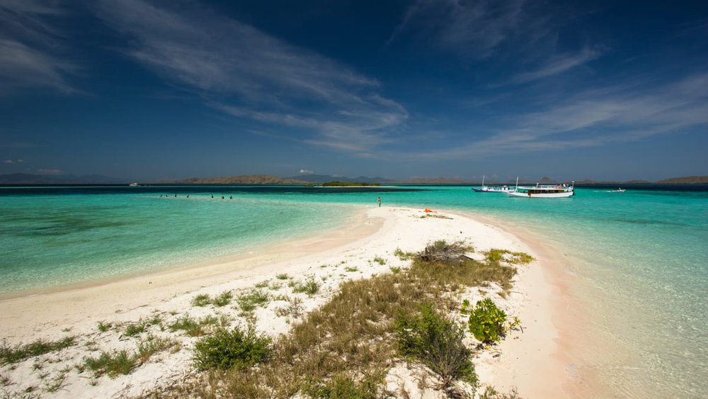 A view of Pulau Makassar, a small island with white sands and green grasses