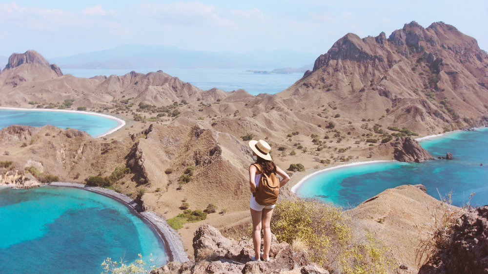 A woman enjoying Padar island panoramic view on the top