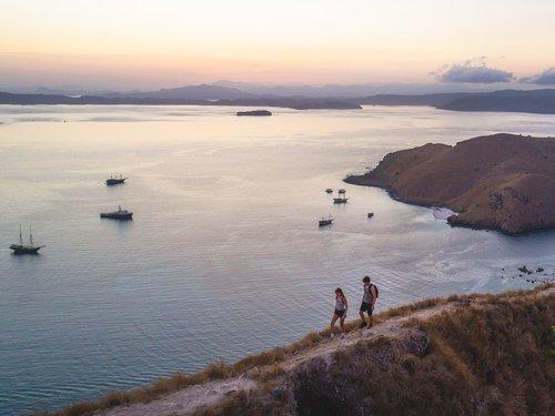Tourists trekking the hills on an island