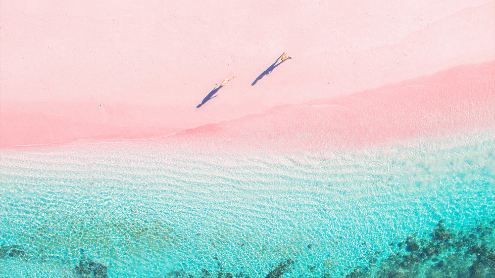 Take a nice walk on the Pink beach on a sunny day