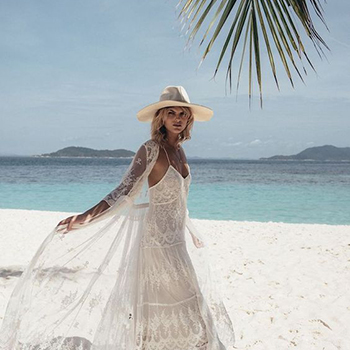 A woman wearing a white dress in the beach