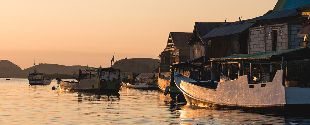 An evening view of boats docked in Flores
