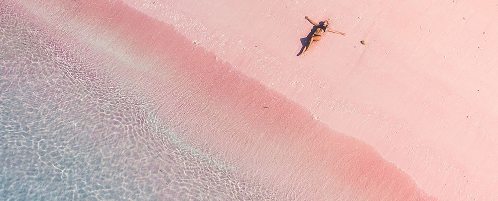 Laying in the sand of Pink beach