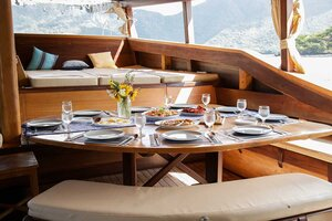 An elegant dining area in Tanaka liveaboard complete with the utensils and comfy seatings