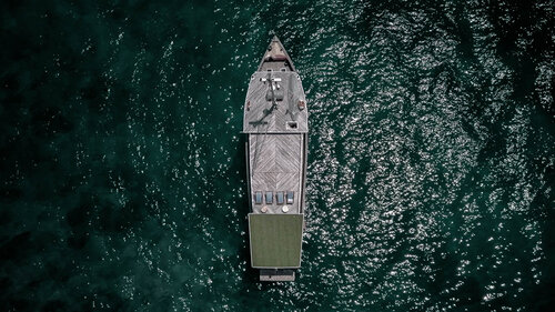 Aerial view of the Splendour liveaboard in the middle of ocean