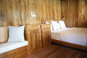 The bedroom in Andamari liveaboard with a double bed and a comfy couch