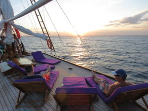 Two guests relaxing on the Carpe Diem liveaboard deck