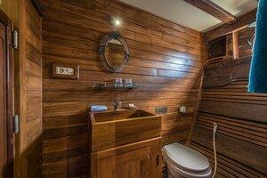 The bathroom inside Carpe Diem liveaboard is simple but clean