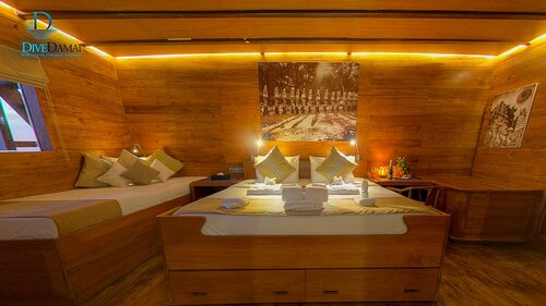 Bedroom with a double bed for Damai II liveaboard guests