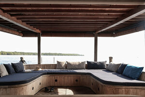 An outdoor lounge on the back of Splendour liveaboard