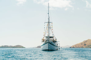 The Royal Fortuna liveaboard seen from the front while sailing in the sea
