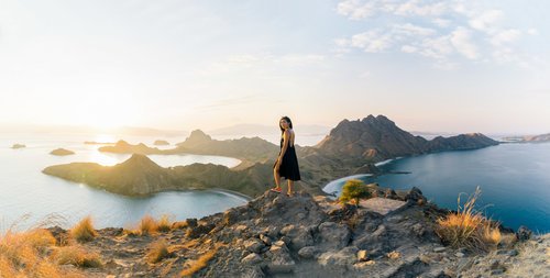 A guest pose on the top of Padar hills after traveling with Royal Fortuna liveaboard