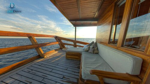 The cabin for Damai II liveaboard is complete with a balcony