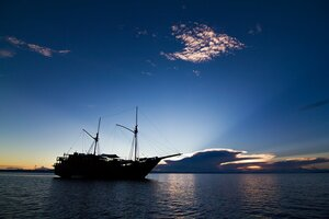 Damai I liveaboard illuminated by the sunrise