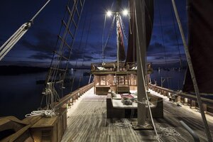 Tiare liveaboard deck at night illuminated with beautiful lights