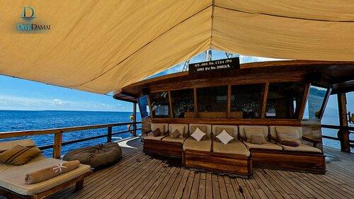 Enjoy the sunset on Damai II liveaboard deck