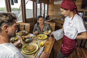 Guests are served with one of our crew in Tiare liveaboard dining area