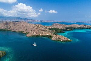 Aerial view of Tanaka liveaboard exploring the island in Flores