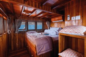 Elegant bedroom inside Helena liveaboard