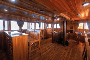 A spacious indoor dining area in Helena liveaboard