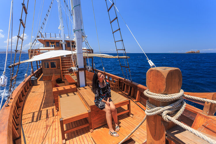 A guest relaxing on Helena liveaboard deck while enjoying the view