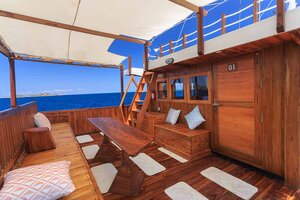 Enjoy the ocean breeze from the deck seating area on Helena liveaboard