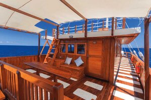 Helena liveaboard provides a cozy lounge on its stern deck