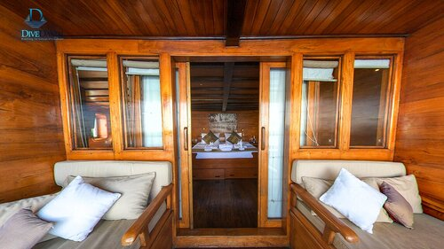 Damai II liveaboard gives you a bedroom with a couch outside