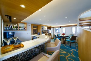Variant of drinks on the cozy bar inside Salila liveaboard
