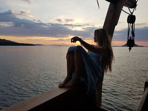 A guest is enjoying the sunset from Nataraja liveaboard