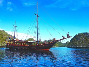 Nataraja liveaboard with the sail down near an island