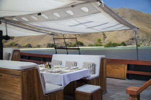 An open-air dining area with nice scenery in Samata liveaboard