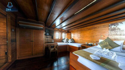A bedroom in Damai II liveaboard is complete with a nice furniture