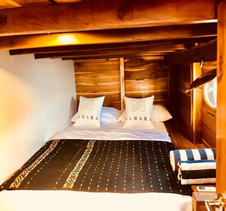A comfortable main bedroom inside Samara II liveaboard