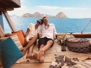 A couple enjoying their time on Samara II liveaboard deck