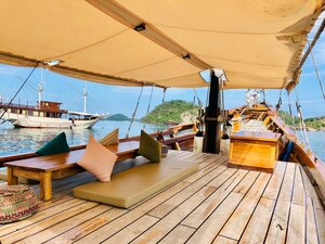 Samara II liveaboard deck is perfect for lazing around in the wooden floor