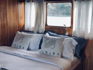 The comfortable main bedroom of Samara I liveaboard