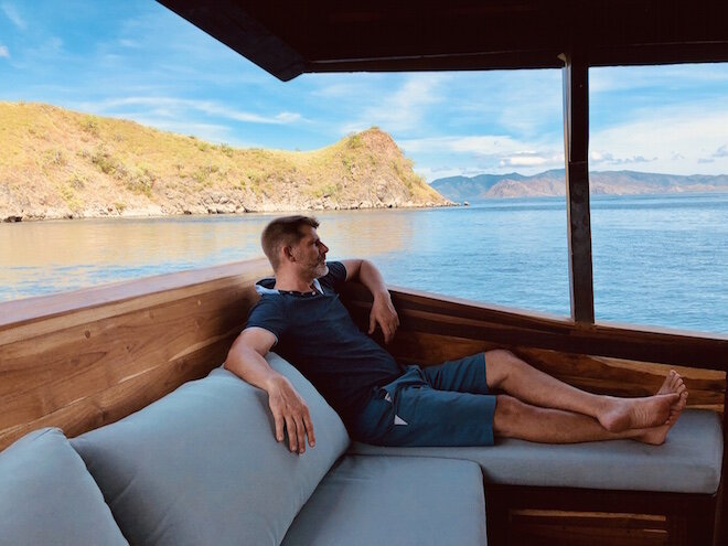 A guest relaxing and enjoying the view on the deck of Samara I liveaboard