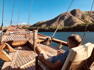 A guest relaxing on the chair while sightseeing from Samara I liveaboard