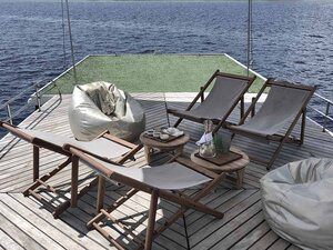 Relieve stress in Splendour liveaboard deck area with a small grass field