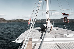 A guest enjoying her time in Splendour liveaboard by relaxing on the deck
