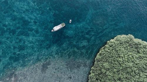 Splendour liveaboard approaching an island in Komodo