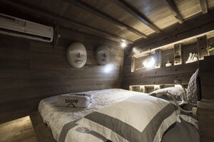 The main bedroom in Tiare liveaboard with wall decorations