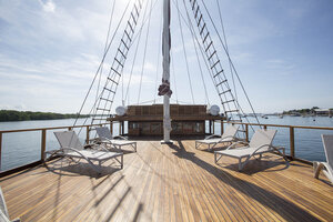 Tiare liveaboard main deck provides a spacious area with lazy chairs