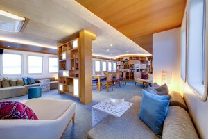 A spacious library inside Salila liveaboard