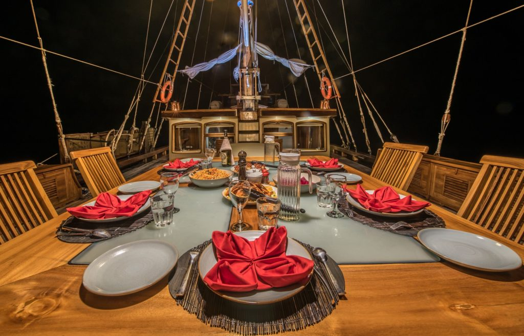 The outdoor dining area on the Carpe Diem liveaboard