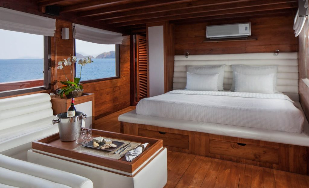 A nice bed and couch on the main bedroom of Samata liveaboard