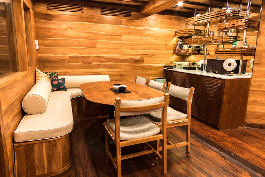 The indoor dining room in Magia 2 liveaboard | Hello Flores