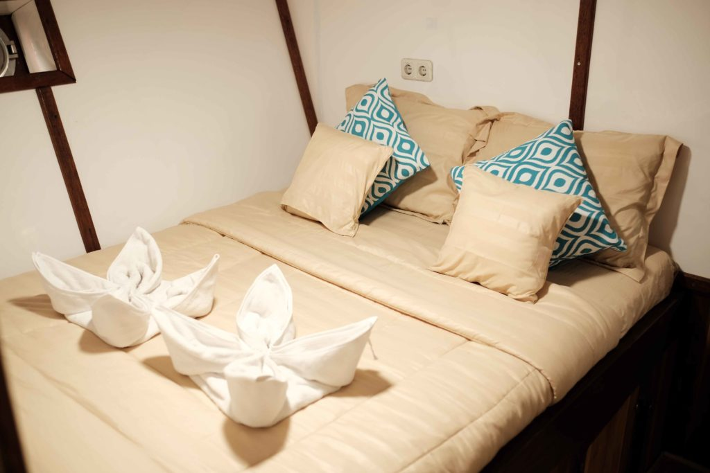 The main bedroom in SInar Pagi cabin with a large bed
