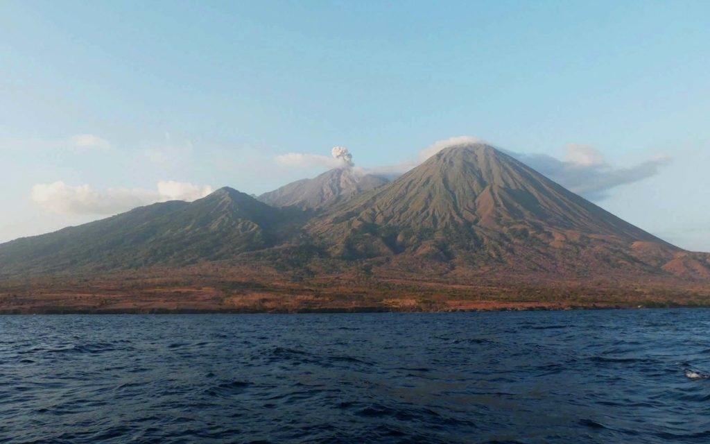 The volcanic Mount Sangeang in the middle of an island